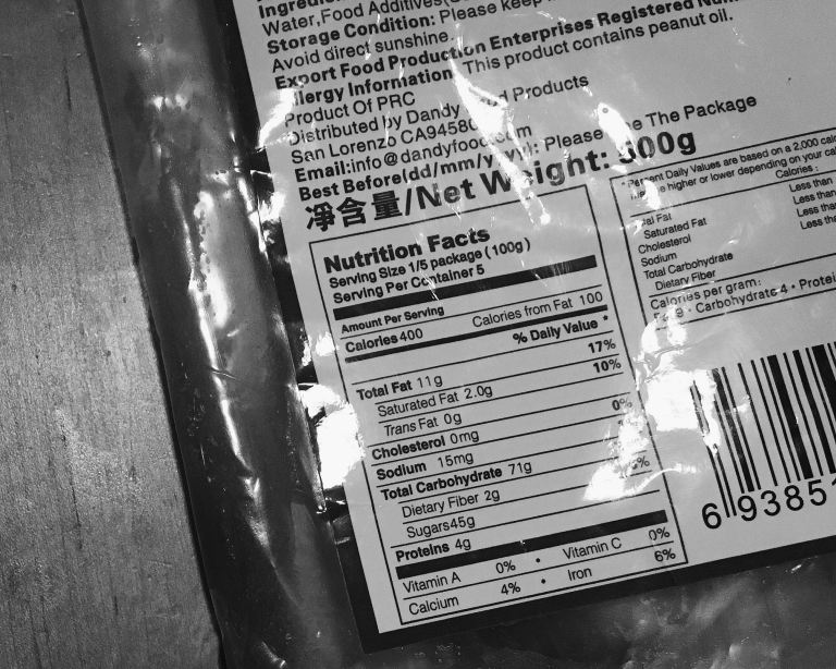 A picture of the nutrition facts of store-bought lotus seed paste. It contains 225 grams of sugar in 500 g packet